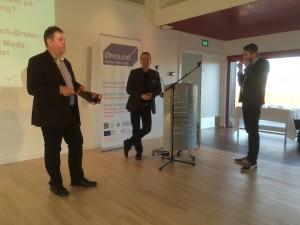 Johan Wessmann, Mark Blach-Ørsten og Jesper Falkheimer præsenterer slutrapporten for projektet